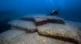 Yonaguni Japan Diver over underwater ruins